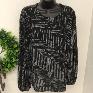 100% polyester black & white blouse size large